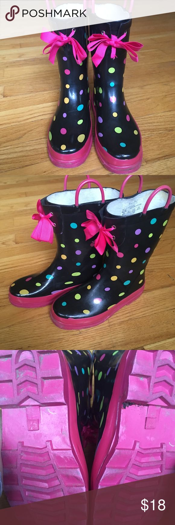 Western Chief Girls Polka Dot Rain Boots These gently worn Western Chief girls' rain boots are pink on the bottom and the signature handles are pink as well. The body has multi-colored polka dots. The pink ribbon bows add an extra flair. Girls' 13/1, as noted on the bottom. $18. Western Chief Shoes Boots
