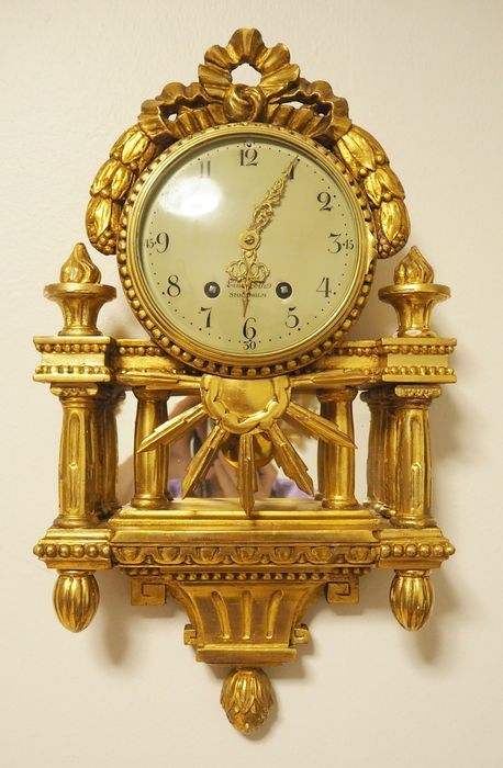 "Currently at the #Catawiki auctions: Swedish ""Linderoth STOCKHOLM"" Gold plated hand carved wooden wall clock - ca...."