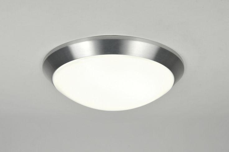 Artikel 71103 Deze plafondlamp is van wit kunststof en heeft een mooie aluminium rand.  De lamp is zeer licht in gewicht. De kap zit aan de plafondplaat vast en is zeer eenvoudig te openen door de bajonetsluiting een slag te draaien.  De plafondplaat is van aluminium. Inclusief: 1x 22 watt T5 (ECO) energiezuinige lamp.