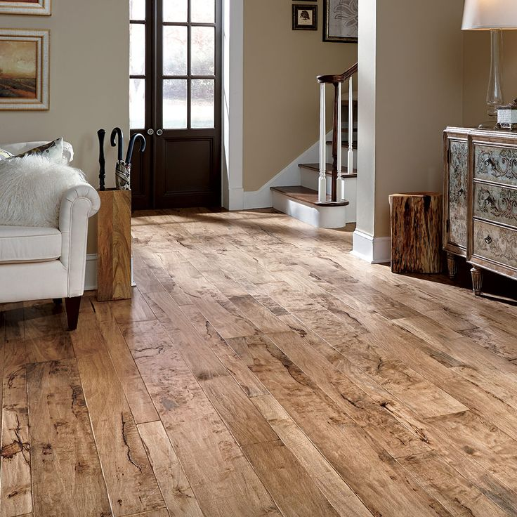 Pacaya Mesquite, a rustic hardwood that's hand-scraped and hand-stained to create a beautiful antiqued floor.