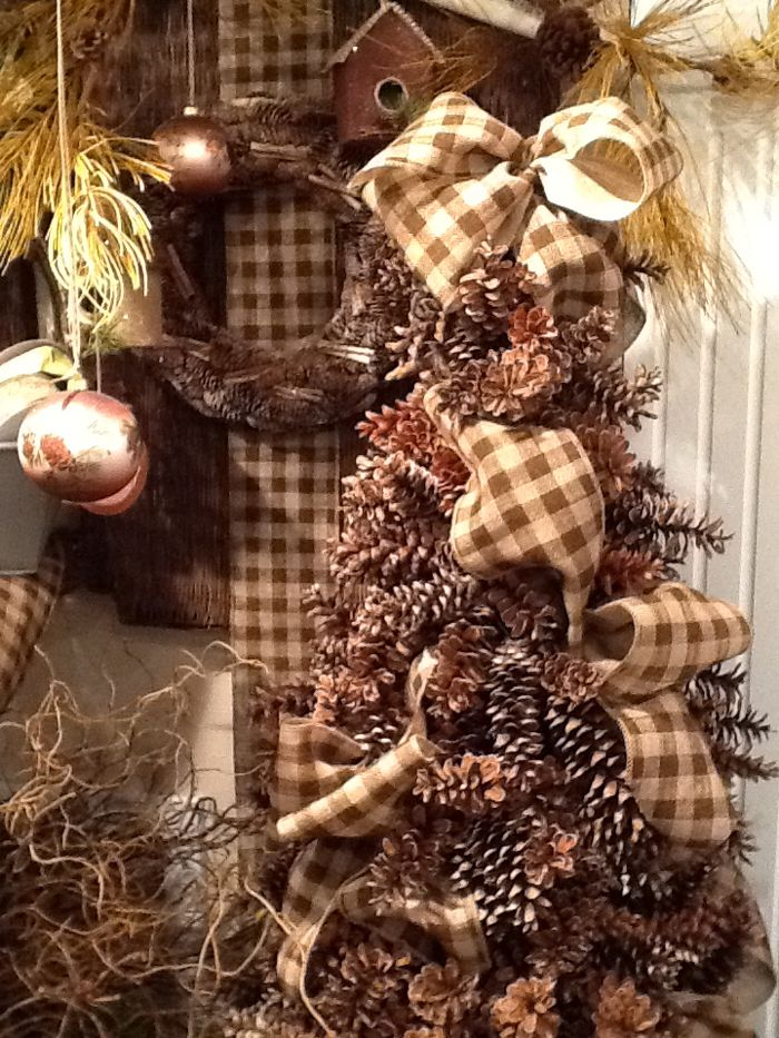 Pine Cone Tree decorated with Burlap Check Ribbon - made from pine cones wired around a tomato cage. Tutorial coming soon!