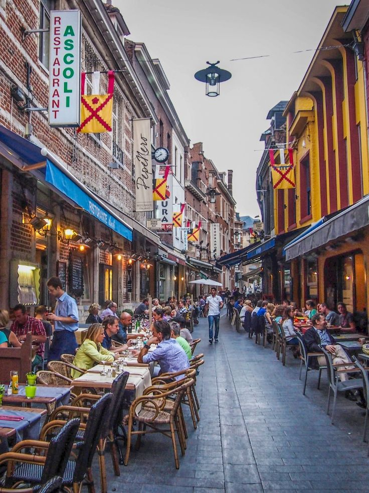 Restaurants and bars on Muntstraat in Leuven, Belgium.