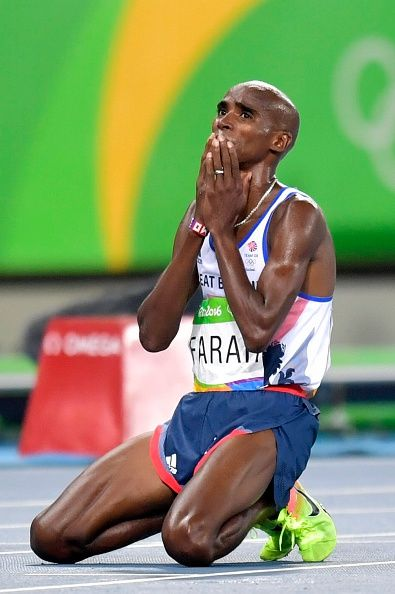 Mo Farah of Great Britain celebrates his win at the Men's 10000m race at the…