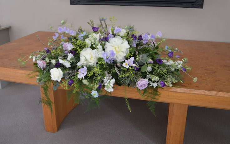 Rustic ceremony piece for wedding at Russets Country House. Summer blue flowers by Eden Blooms.