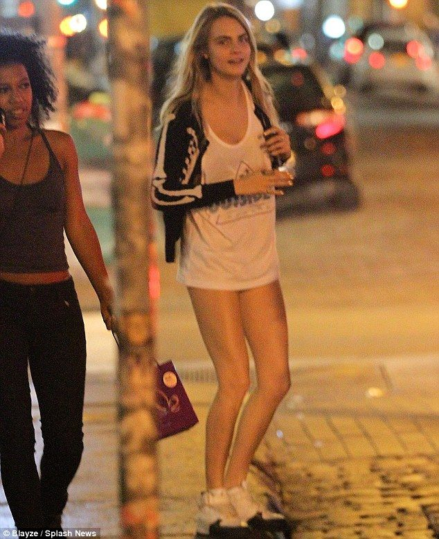 Cara Delevingne was spotted trying to hail a cab in New York wearing little more than a T-shirt http://dailym.ai/1l7XkZi