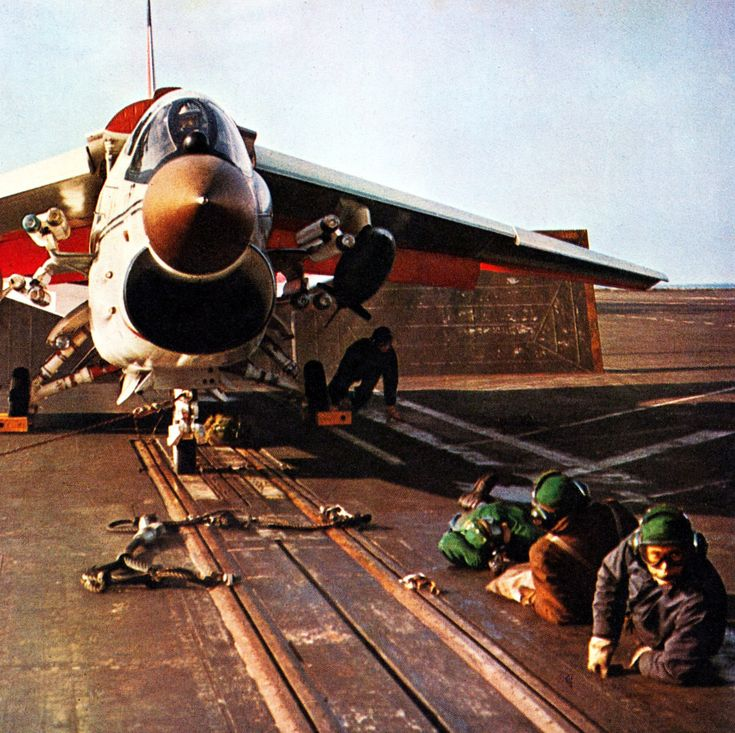 F-8 Crusader...but what is the a/c armed with on the cheek pylons?  I have never seen that configuration!  Anyone know?