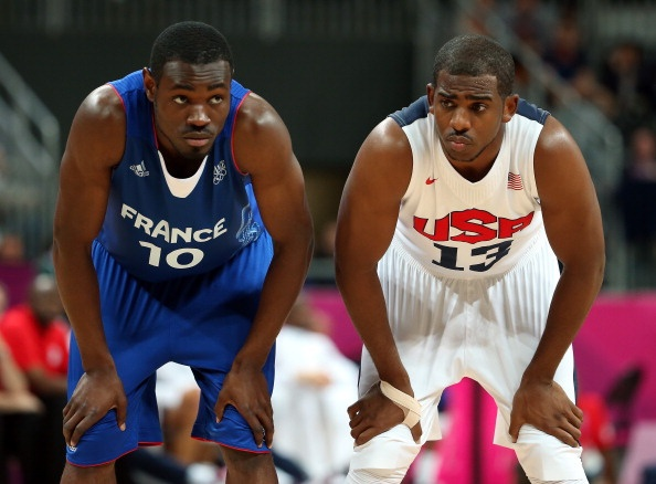 Yannick Bokolo #10 of France looks on against Chris Paul #13 of United States during their Men's Basketball Game on Day 2 of the London 2012 Olympic Games at the Basketball Arena on July 29, 2012 in London, England.