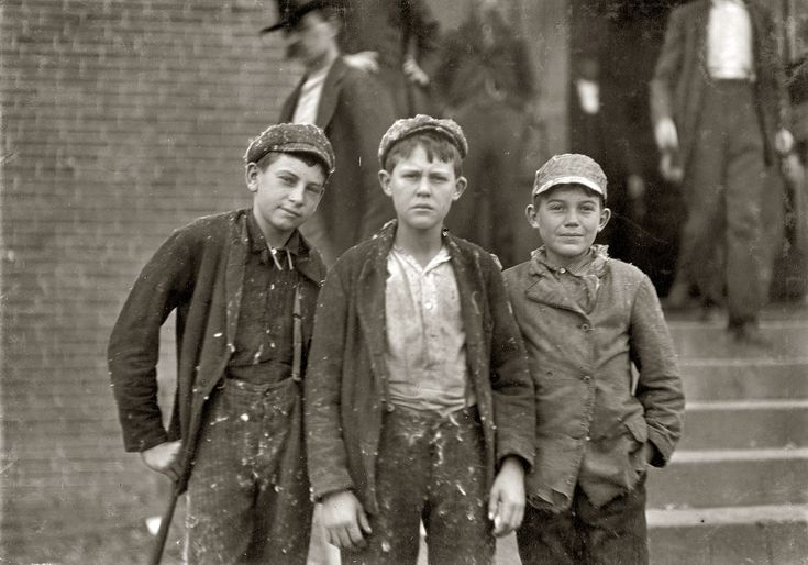 Loray Mill: November 1908. Gastonia, North Carolina. Going home from Loray Mill. Smallest boy on the right-hand end, John Moore. 13 years old. Been in mill 6 years as sweeper, doffer and spinner. Photo by Lewis Wickes Hine.