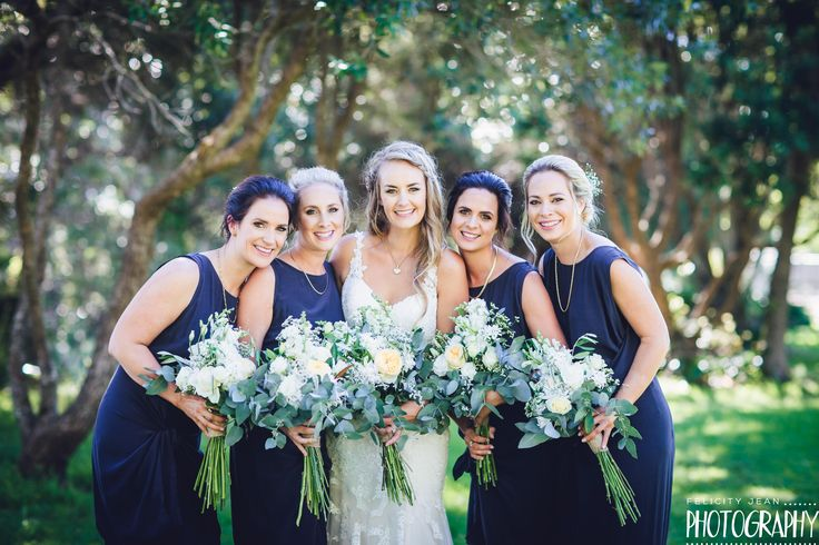 what a gorgeous line up...beautiful wedding at Lover Rock Whitianga