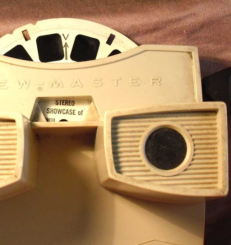 Viewmaster - I had one of these tan Viewmasters as a girl, along with a box to hold it and the reels. I spent hours looking at the images on the reels imagining going to the places pictured.
