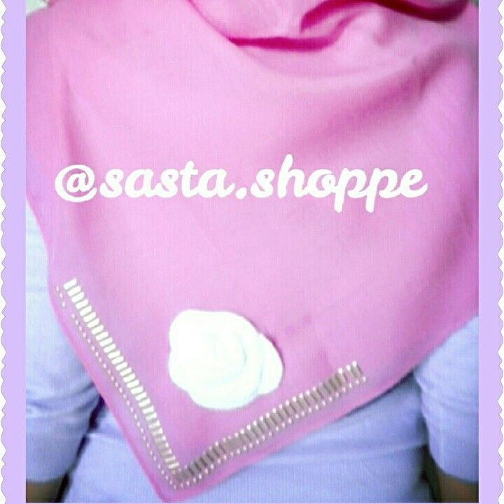 a soft-pink square hijab with white flower and gold details. follow our IG @Sasta.Shoppe for further info.