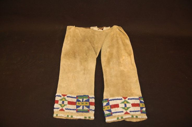 Pair of child's legging made of leather, beads.