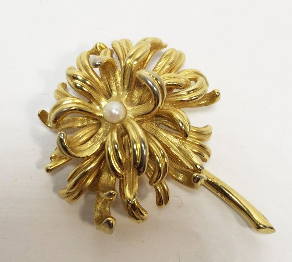 This is a beautifully detailed Boucher Chrysanthemum brooch and earring set from the 1960s featuring a small cultured pearl in the centre of