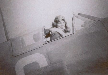 """Sgt John S Anderson of No 152 Squadron RAF sits in Spitfire Mk II UM-C at RAF Warmwell in 1940. Arriving on 29 September, the 19-year-old pilot began combat training on 2 October. Damaging the undercarriage on landing on 14 October, he went round again on his second approach, when the weakened wheeled gear collapsed resulting in a slide along the turf. The """"slight miscalculation"""" earned him a logbook endorsement from station commander W/C George Howard."""