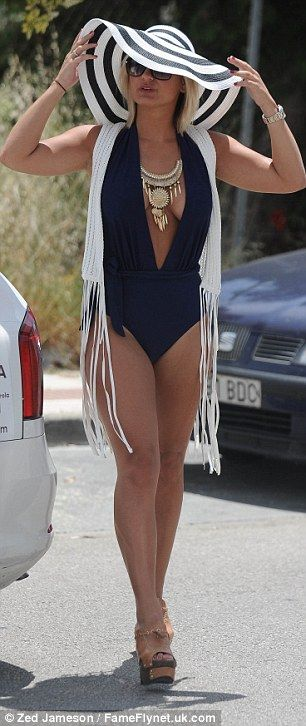 Look at me! Sam looks thrilled to be the centre of attention as she arrives at the Sisu Club in Puerto Banus to film scenes for TOWIE