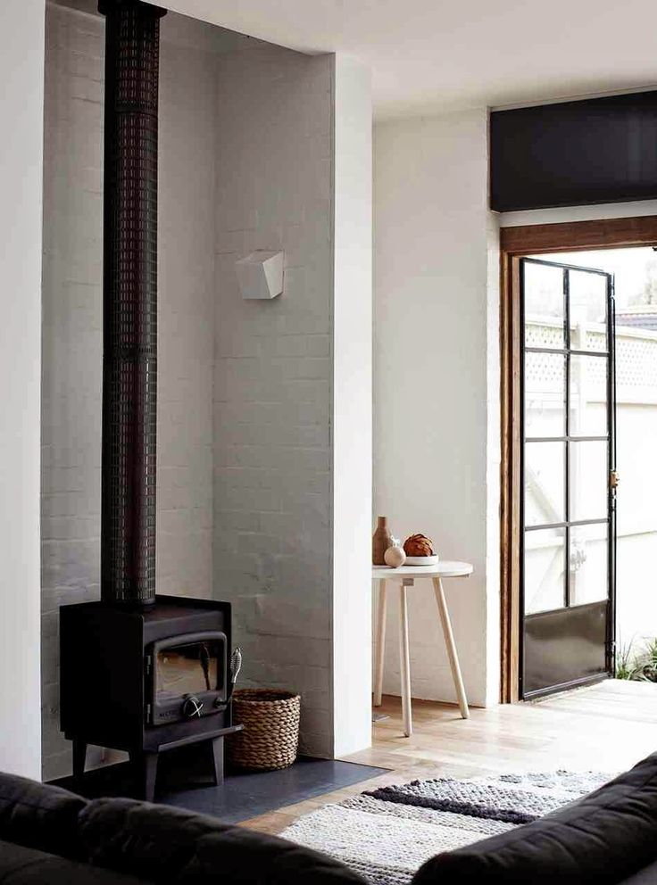 A zen Australian home with fabulous architecture. Whiting Architects, and Nectre Australian made wood fire