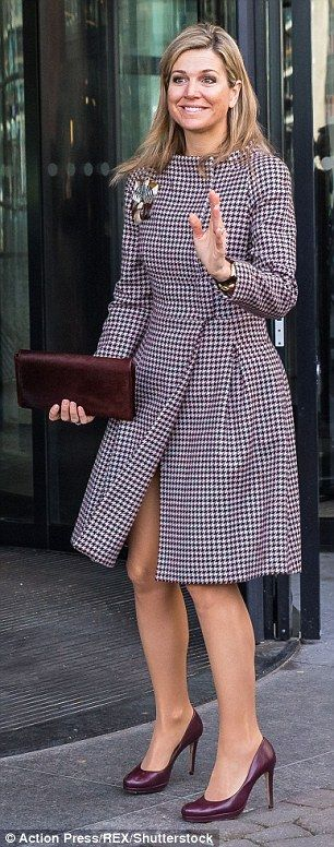 Maxima looked elegant in a hounds-tooth dress coat...