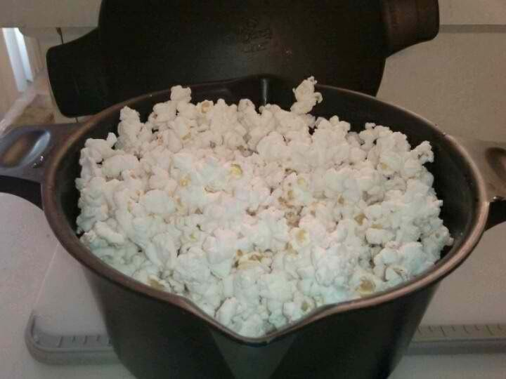 If you have a Pampered Chef micro cooker you can make microwave popcorn in minutes! Take 1/4 cup popcorn-cover loosely with lid and nuke for 1:50-2:10. Fresh crunchy and healthy!  Add a splash of butter and salt for corny perfection