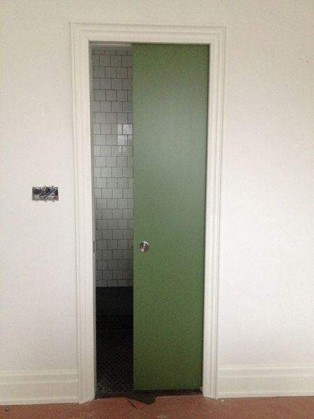 green pocket door in Farrow & Ball's Calke Green #34