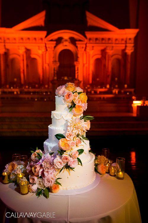 White Wedding Cake with Cascade of Fresh Flowers | Brides.com