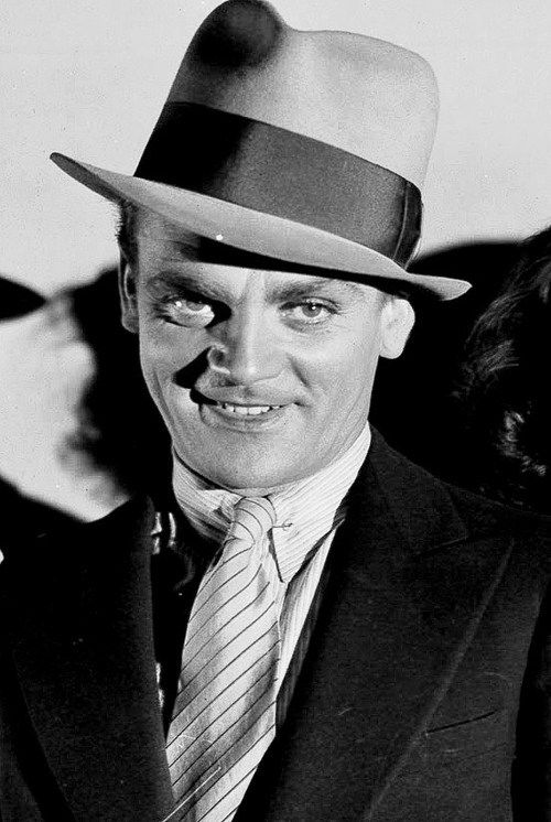 "James Cagney in Taxi! (1932). This movie is the source of James Cagney's most famous misquoted line, ""You dirty rat!"" In the film, Cagney actually says, ""Come out and take it, you dirty, yellow-bellied rat, or I'll give it to you through the door!"""