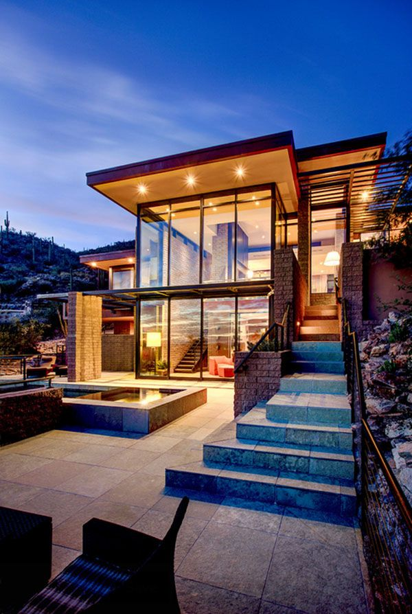 Multi level desert home organically forms into the