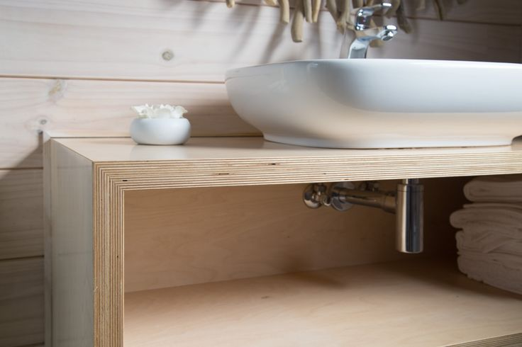 The edges of the birch plywood are left visible in the sink cabinet showing greater detail in the finish.