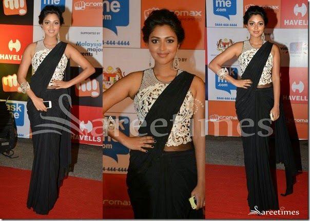 South Indian actress Amala Paul looking beautiful in black Sonaakshi Raaj saree at SIIMA 2014. Contrast with embellished sleeveless saree blouse.