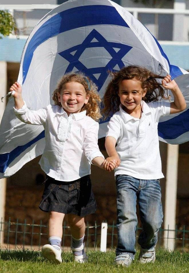 Happy children with the Israeli flag