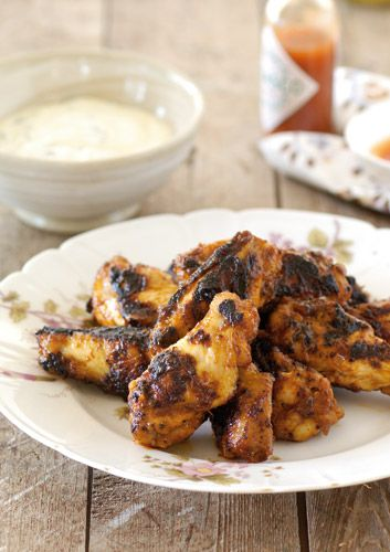 Spicy buffalo chicken wings with ranch dressing.