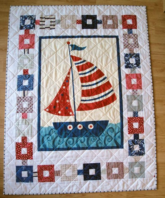 SerendipitiJoy: Nautical quilt 2 finished. I love the border with the colored squares and the white.