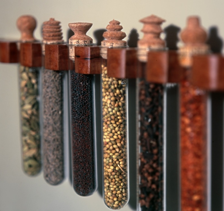 Some day when I've bought some test tubes and found enough spare time to carve corks into snazzy designs, I'll make these awesome spice holders.  Or...I could just buy them from Jonathan Catt Design.