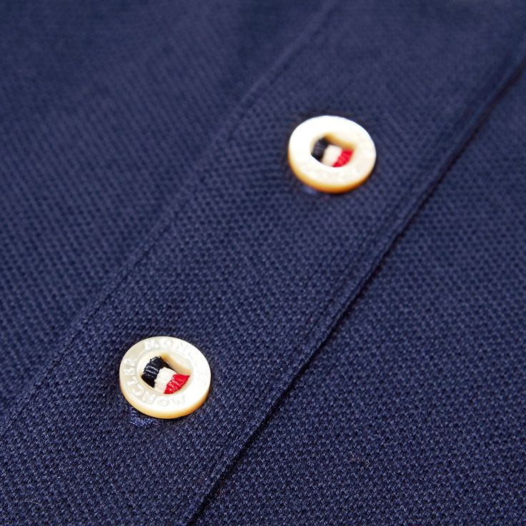 The Classic Grosgrain Placket Polo from Moncler's SS14 collection is constructed to the same high standards that have made them the brand of choice for European Hikers and Skiers since 1952. Made from a 100% cotton pique fabric with a two button placket and a ribbed collar, cuffs and hem, this top quality polo is finished with a split hem and Moncler's felt logo appliqué. 100% Cotton Pique Ribbed Collar and Cuffs Two Button Placket Felt Logo Appliqué Split Hem Style Code: 83408-00-709…