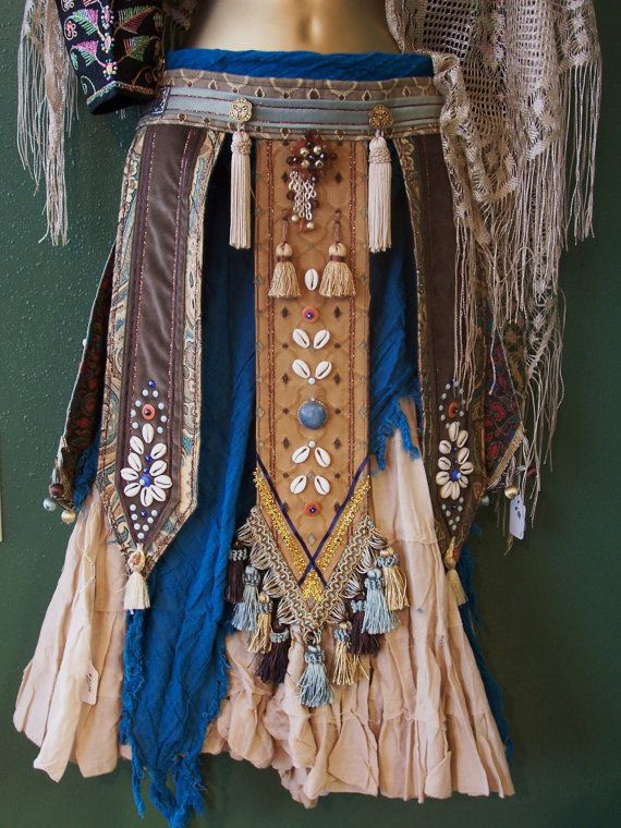 @: Dance belt with skirt. It gives great movement and drama to the outfit or music. I have taken an eclectic assortment or old world jewelry and added tassels and trims of various textures and colors to give this belt a unique appearance.The measurements are;  Length- 39inches with 18 inch ti...