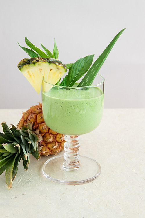 Pineapple/ Aloe vera Smoothie - 1 cup spinach ¼ cup fresh mint 1 cup pineapple, frozen 2 tablespoons aloe vera juice, or a 2 inch fillet straight from the plant 2 teaspoons honey ½ inch fresh ginger, peeled and minced ¼ teaspoon tumeric powder 1 lime, peeled ¾ cup coconut water