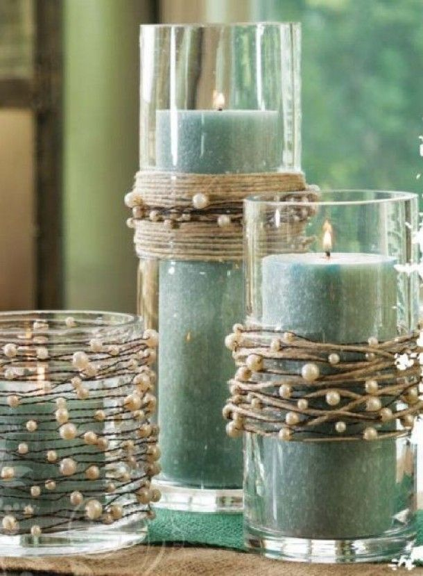 String pearls on twine and wind around vases or candle holders. Cute rustic look