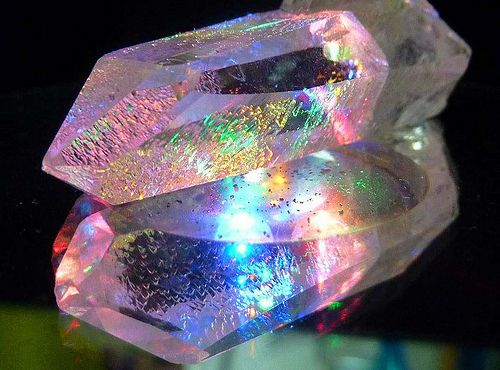 Quartz Crystal Angel Aura. Angel Aura Quartz Crystals are created by bonding a natural clear Quartz crystal with a precious metal infusion of pure platinum and silver...