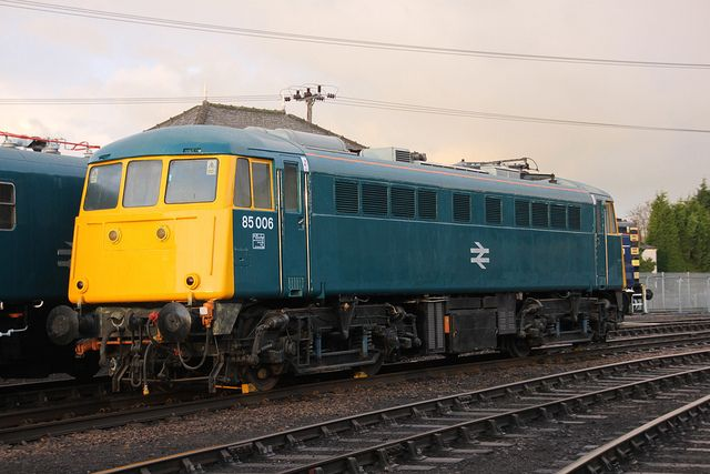 85006 (E3061) at Barrow Hill on 7th Dec 2013.(Now actually numbered 85101 but repainted for a short period) Built at Doncaster Works and delivered on 20th Dec 1961. Renumbered to 85101 on 9th June 1989. Withdrawn on 8th Nov 1991 and now preserved by the AC locomotive Group at Barrow Hill.