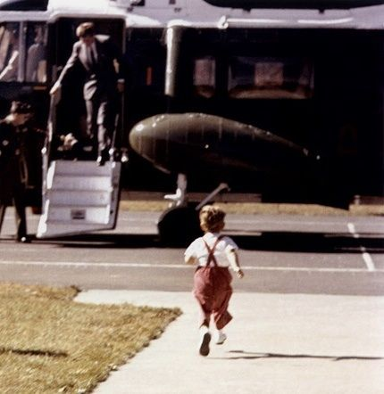 John Jr. runs to welcome his father, President John F. Kennedy, as he gets out of the helicopter.