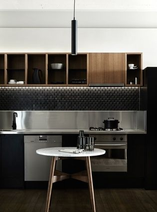 Original joinery has been discreetly updated with a new benchtop, blackened steel shelves and a new upright unit that houses the fridge.