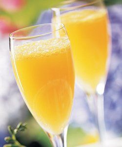 Peachy Mimosas: 2 cups orange juice, chilled - 2 cups peach nectar, chilled - 1 liter bottle dry champagne or sparkling wine, chilled. Mix orange juice and peach nectar in a pitcher and pour glasses until half full. Fill glasses the rest of the way with champagne.
