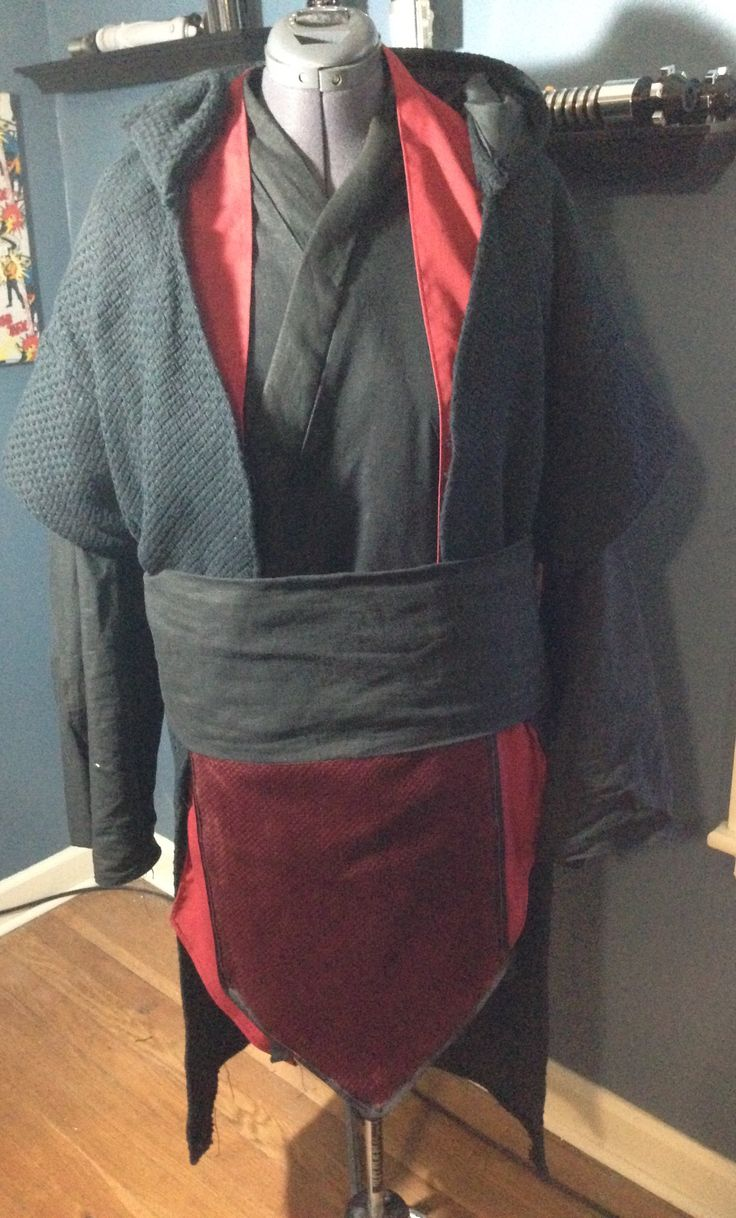 "Sith Lord costume. Obi added, created from same material as outer tunic. Measured against 2"" leather belt with 2"" on each side, top and bottom. Sewed center front tabard into obi and then matches up even on bottom."