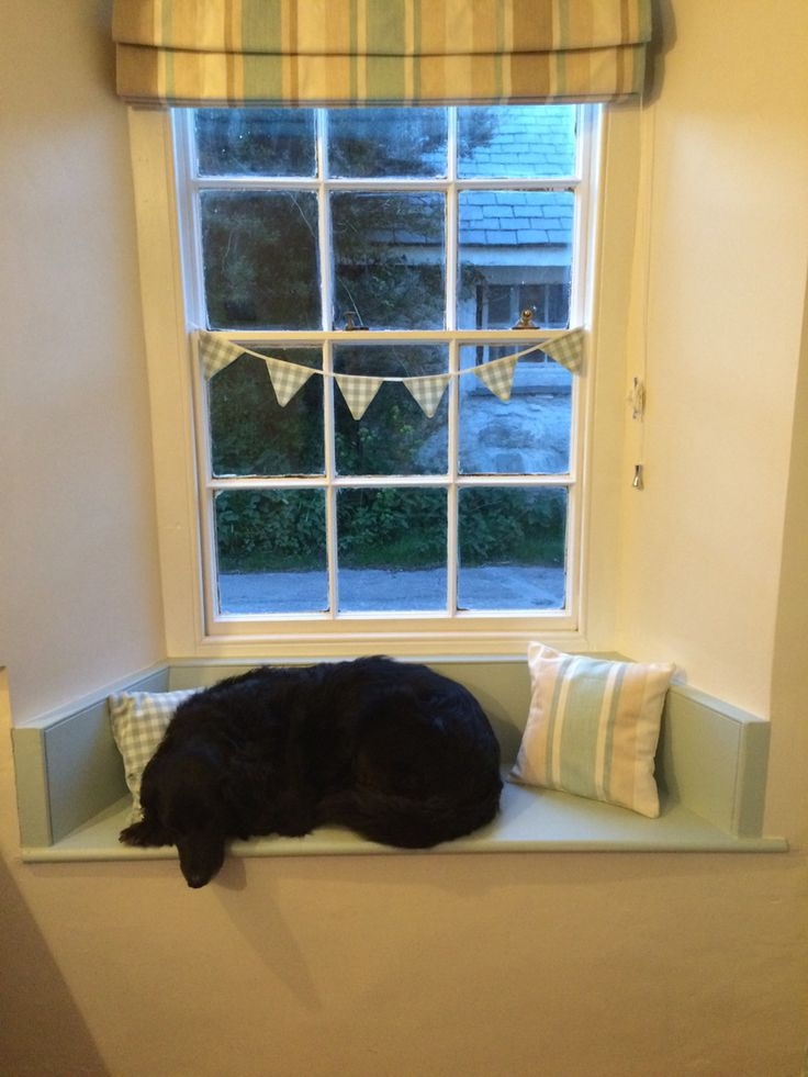 Our kitchen window seat painted in Laura Ashley Duck egg eggshell paint. The dog is rather pleased with it