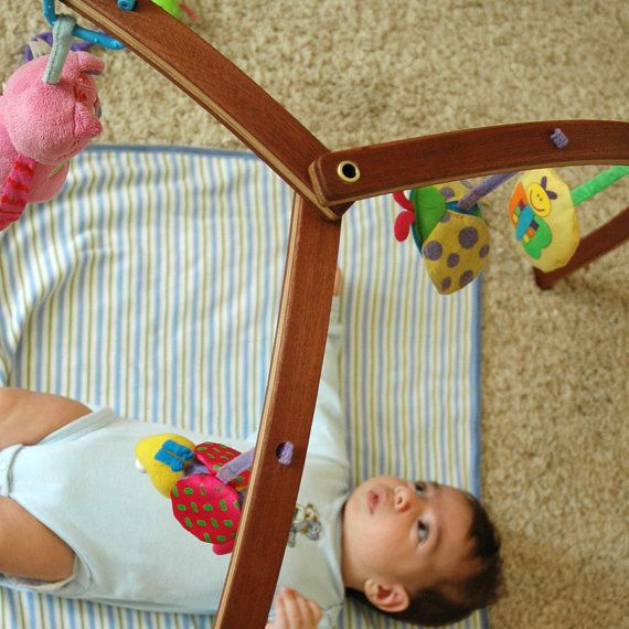 Wooden baby gym for hanging baby mobiles. $88.00, via Etsy.