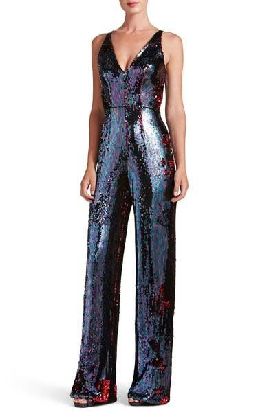 A dense covering of satin-finish sequins flatters and flaunts the figure in this party-ready jumpsuit.