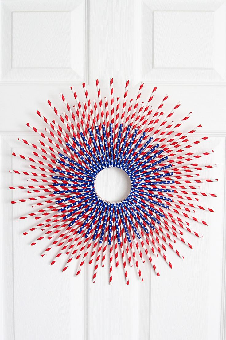 Looking for a fun and interesting way to add some patriotic flare to your front door or mantel? I have you covered with this striking DIY patriotic wreath. And in case you couldn't tell, it's made of mostly paper straws. Grab some red and blue paper straw