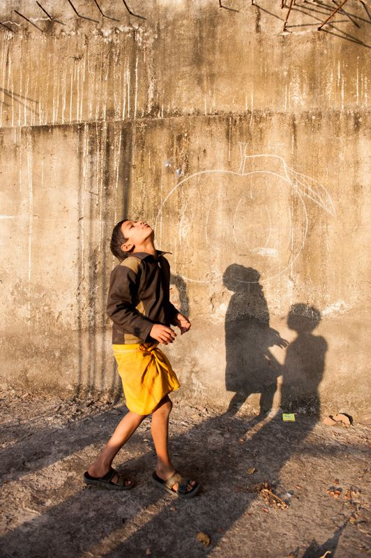 india, kids, afternoon light, games, amazing outdoor space, golden light, playfulness, new york photographer, shadows, texture wall, rustic, rural, from the series Us Shiva