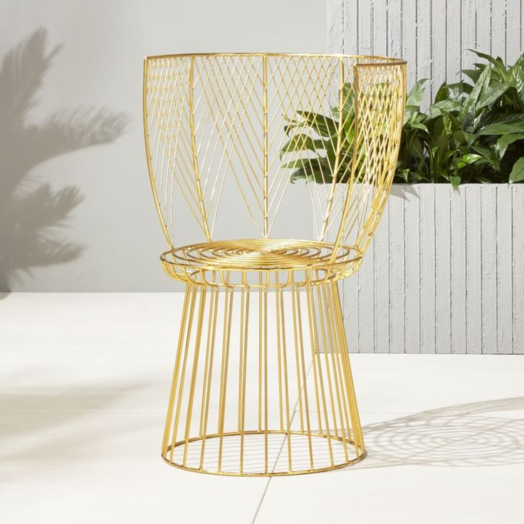 Shop alexandria gold outdoor chair.   Stunning gold seat demands  attention from any angle.  Iron rod frame is cut and bent by hand creating an elegant curved back with fine feathery details.  A true statement piece for the season.
