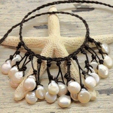 Pearls. I would thread some seaglass or sea pottery on here as well.
