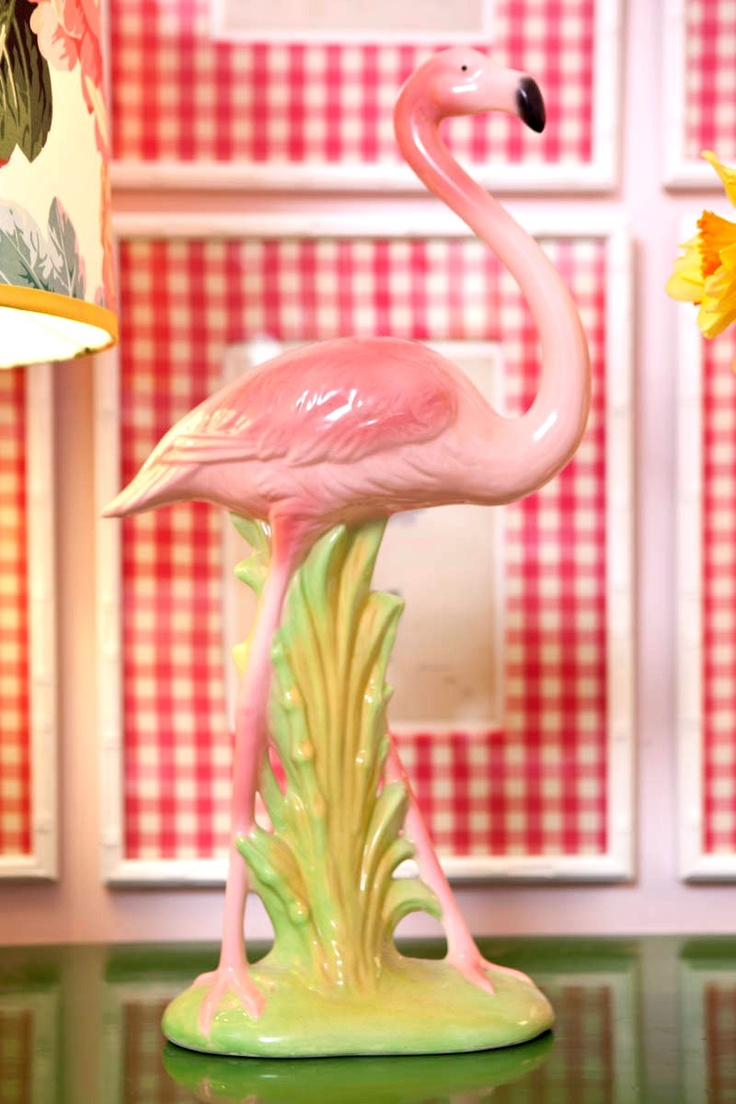 Pink Flamingo. I have NO idea what I love so much about this decoration, but wouldn't it be perfect for my Jimmy Buffett themed kitchen... which just so happens to have lime walls and pink appliances?